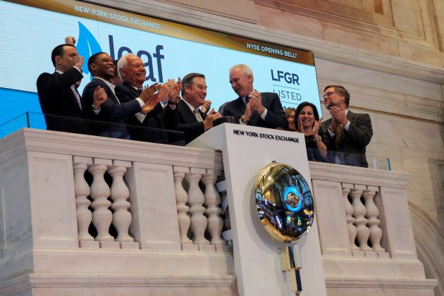 Leaf Group CEO Sean Moriarty (4th L) stands amongst Leaf Group management and board members for the opening bell at the New York Stock Exchange (NYSE) in Manhattan, New York City, U.S.