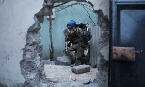 An Iraqi Special Forces soldier moves through a hole as he searches for Islamic State fighters in Mosul, Iraq.