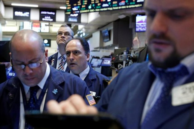 Traders work on the floor of the New York Stock Exchange (NYSE) in New York, U.S., February 28, 2017. REUTERS/Brendan McDermid