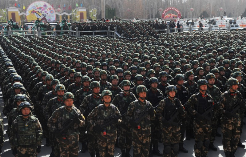 Paramilitary policemen stand in formation as they take part in an anti-terrorism oath-taking rally, in Kashgar, Xinjiang Uighur Autonomous Region,
