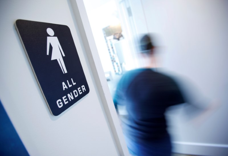 File Photo: A bathroom sign welcomes both genders at the Cacao Cinnamon coffee shop in Durham, North Carolina, United States on May 3, 2016. REUTERS/Jonathan Drake/File Photo