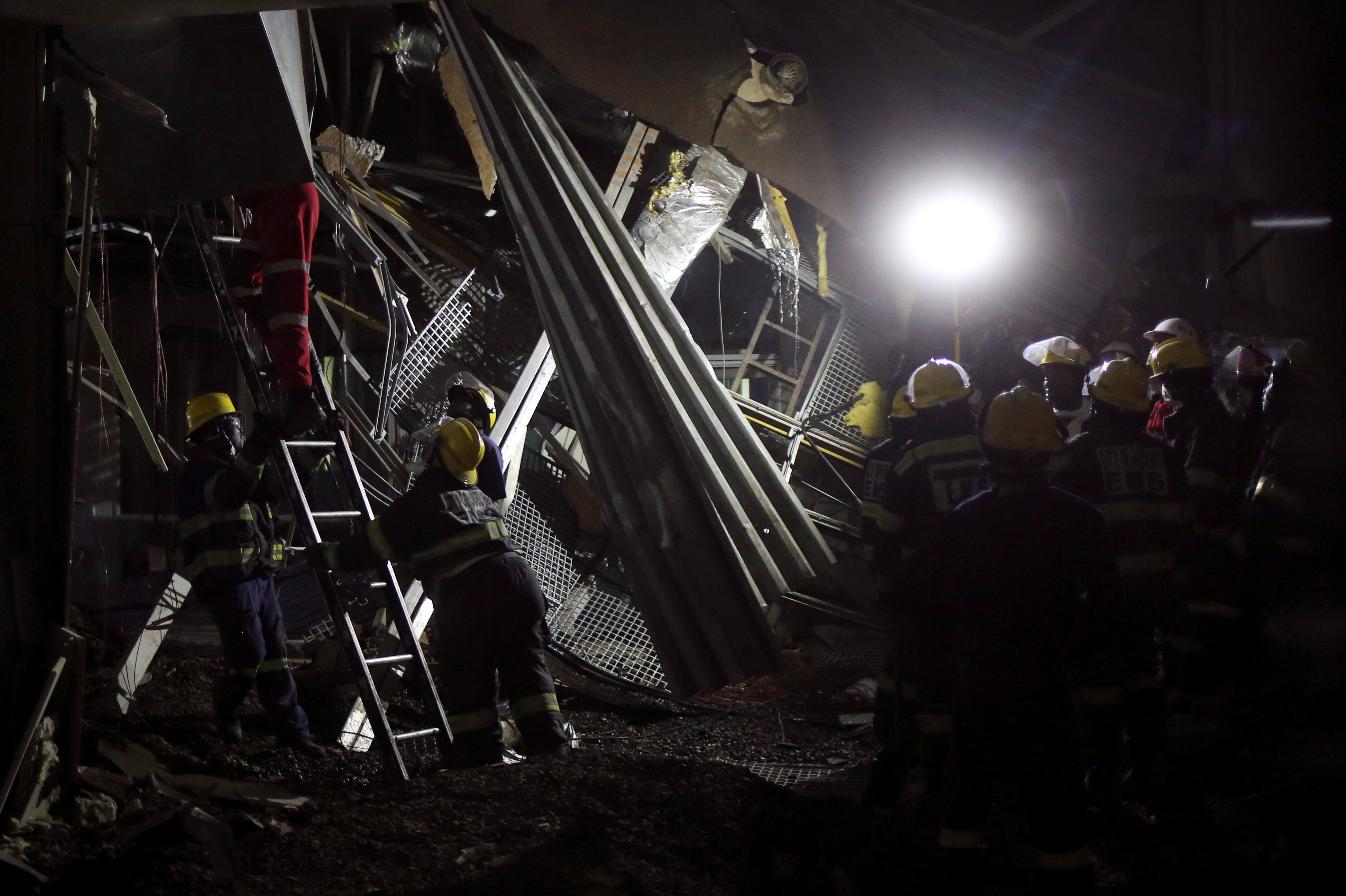 Rescue workers are seen at a site of a roof collapse at Johannesburg's Charlotte Maxeke state hospital in Johannesburg, South Africa. REUTERS/Siphiwe Sibeko