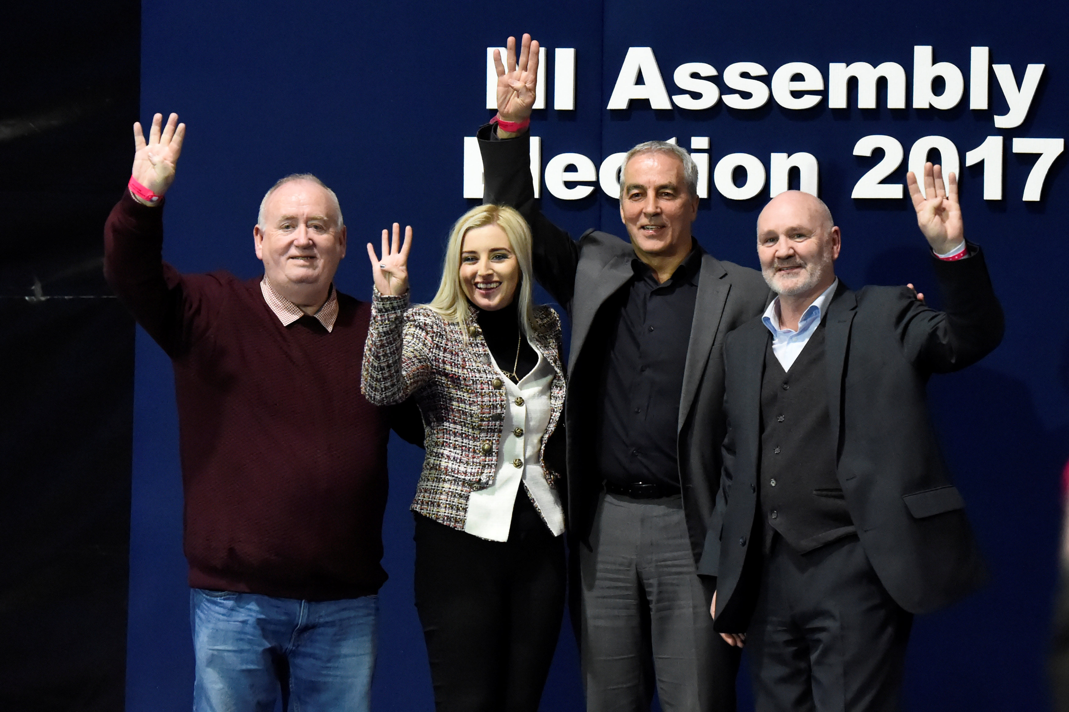 Sinn Fein elected candidates for East Belfast (L to R) Fran McCann, Orlaithi Flynn, Pat Sheehan and Alex Maskey pose on stage at the count centre in Belfast, Northern Ireland March 3, 2017. REUTERS/Clodagh Kilcoyne