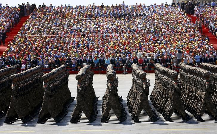 Soldiers of China's People's Liberation Army (PLA) march during the military parade to mark the 70th anniversary of the end of World War Two, in Beijing, China, September 3, 2015. REUTERS/Damir Sagolj/File Photo