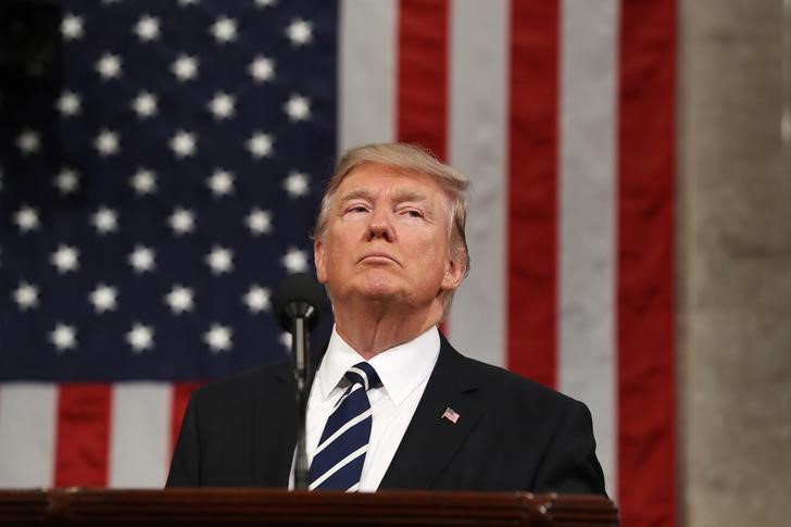 U.S. President Donald Trump delivers his first address to a joint session of Congress from the floor of the House of Representatives iin Washington, U.S.,