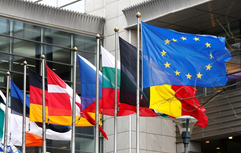European and national flags fly outside the European Parliament while European Commission President Jean-Claude Juncker presents a white paper on options for shoring up unity once Britain launches its withdrawal process, in Brussels, Belgium, March 1, 2017. REUTERS/Yves Herman