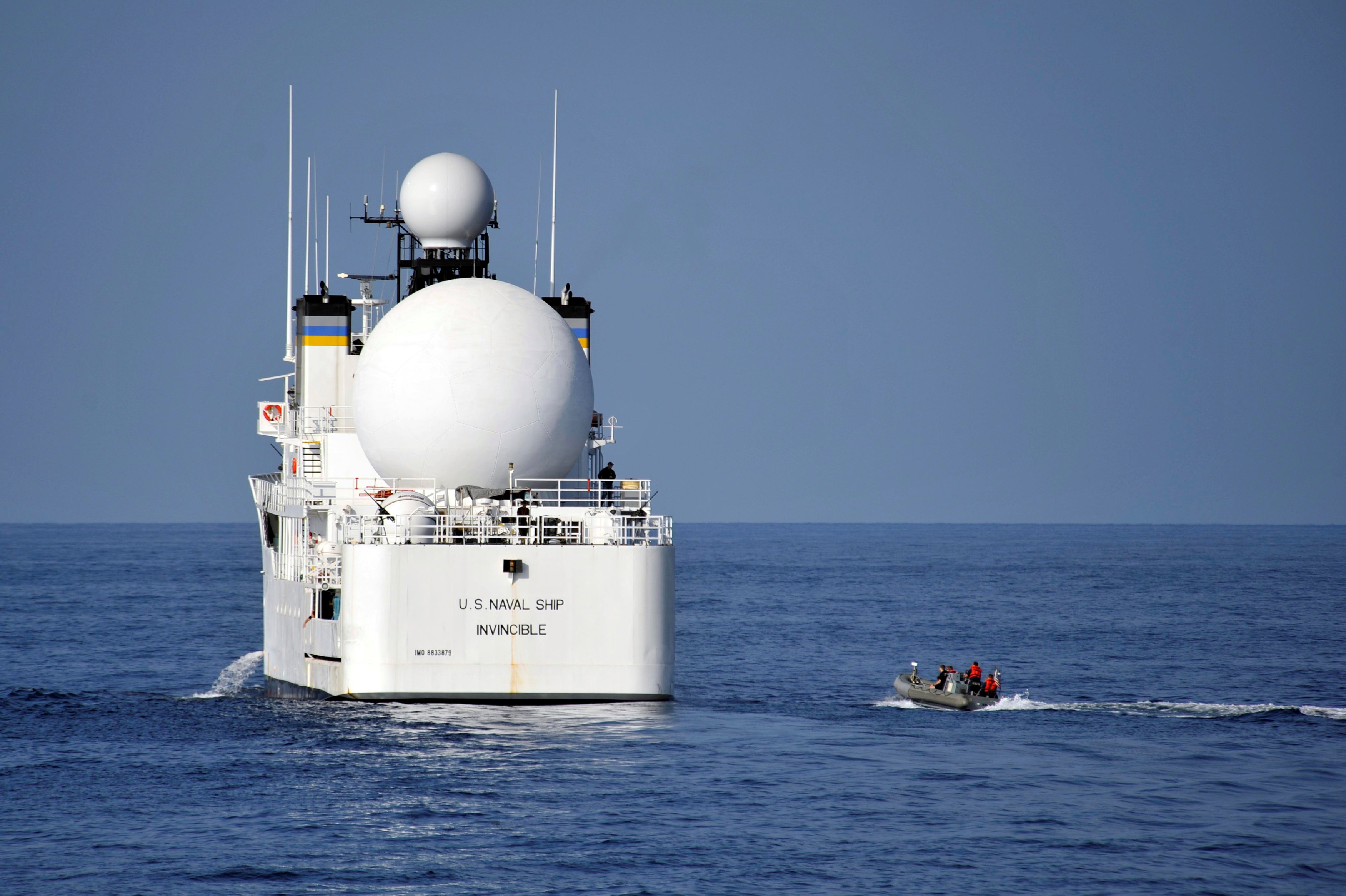 File photo: U.S. sailors in a rigid-hull inflatable boat approach the Military Sealift Command missile range instrumentation ship USNS Invincible (L) to conduct a personnel transfer in Arabian Sea on November 21, 2012. Courtesy Deven B. King/U.S. Navy/Handout via REUTERS