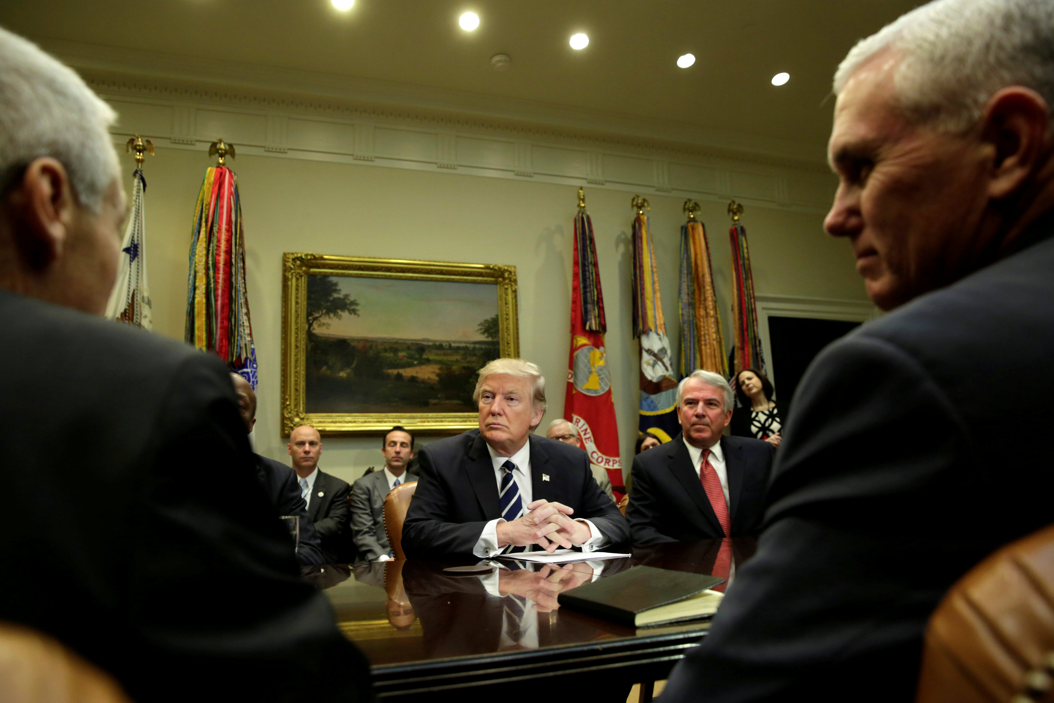 FILE PHOTO - U.S. President Donald Trump (C) and Vice President Mike Pence (R) meet with pharmaceutical industry representatives at the White House in Washington, U.S. on January 31, 2017. REUTERS/Yuri Gripas/File Photo