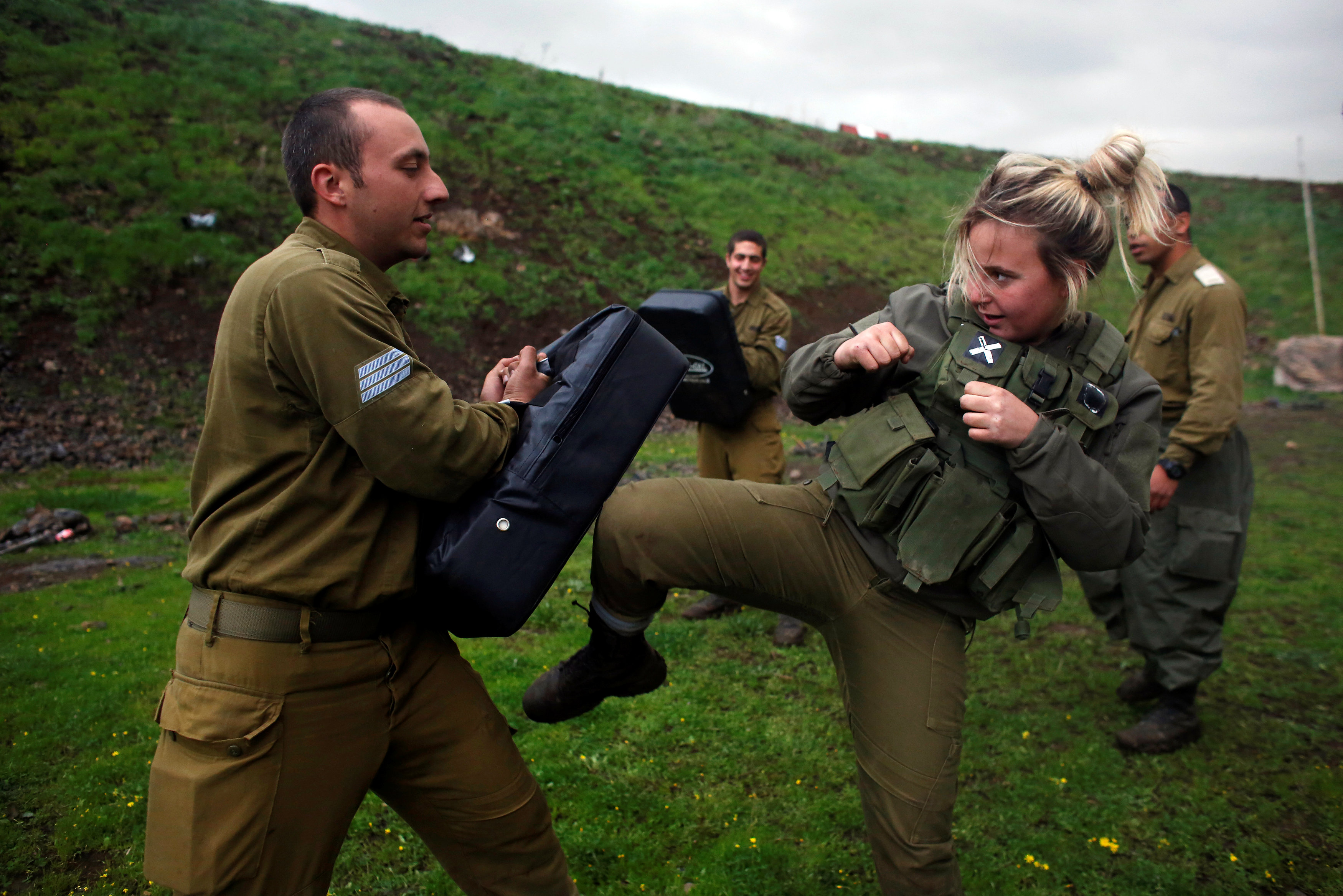 A female Israeli soldier from the Haraam artillery battalion takes part in a training session in Krav Maga, an Israeli self-defence technique, at a military base in the Israeli-occupied Golan Heights March 1, 2017. REUTERS/Nir Elias