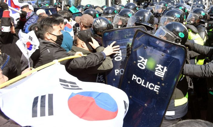 Protesters supporting South Korean President Park Geun-hye clash with riot policemen near the Constitutional Court in Seoul, South Korea. Kyodo/via REUTERS