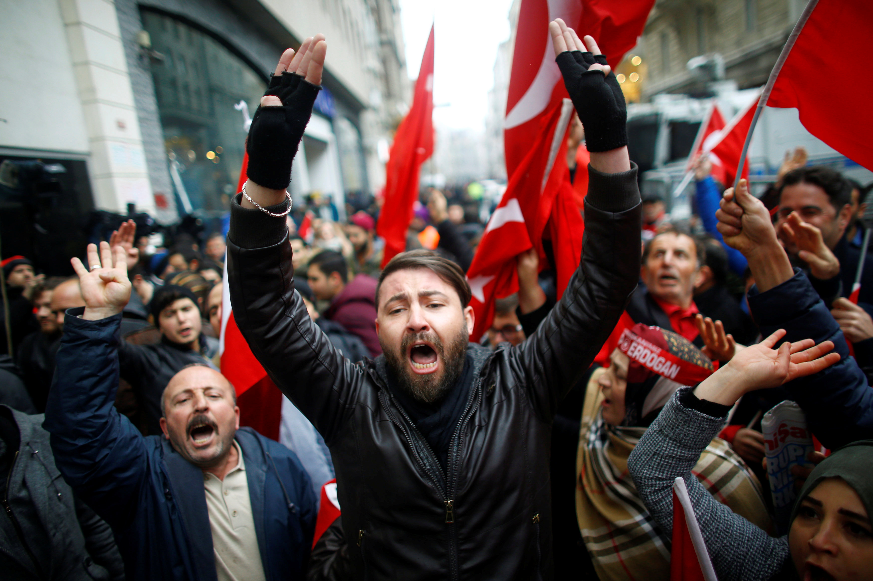 People shout slogans during a protest in front of the Dutch Consulate in Istanbul, Turkey