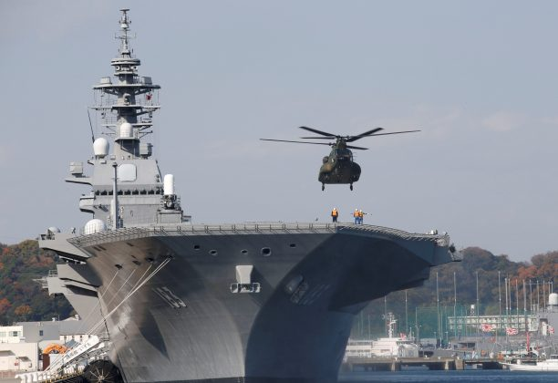 FILE PHOTO: A helicopter lands on the Izumo, Japan Maritime Self Defense Force's (JMSDF) helicopter carrier, at JMSDF Yokosuka base in Yokosuka, south of Tokyo, Japan,