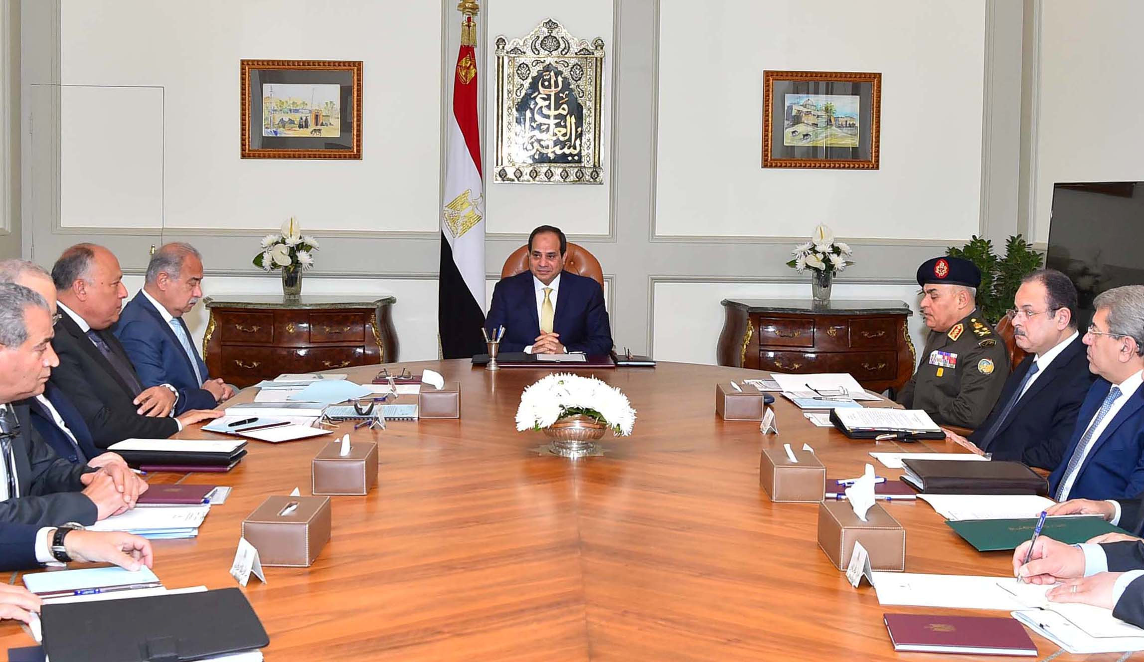 Egyptian President Abdel Fattah al-Sisi (C) meets with his prime Minister Sherif Ismail (4th L) with other ministers and senior State officials at the Ittihadiya presidential palace in Cairo, Egypt March 13, 2017 in this handout picture courtesy of the Egyptian Presidency.