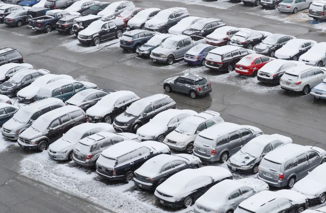 Cars are covered in snow in a general parking lot during the snowstorm at O'Hare International Airport in Chicago, Illinois, U.S., March 13, 2017. Some Chicagoland areas received up to 5 inches of snow, and more than 400 flights were cancelled at O'Hare. REUTERS/Kamil Krzaczynski