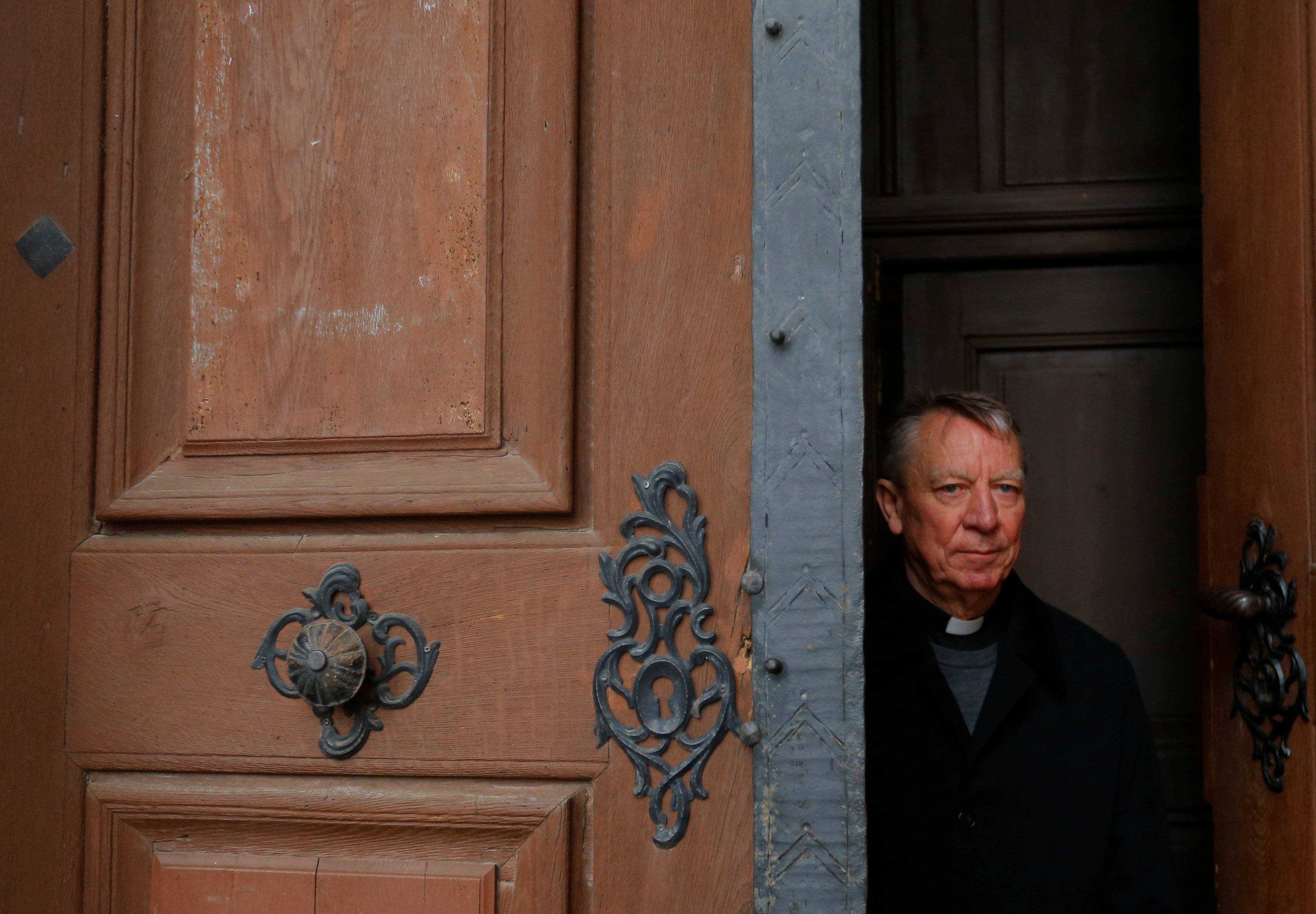 Miklos Beer, the bishop of Vac, stands at the gates of the cathedral in Vac, Hungary March 9, 2017. REUTERS/Laszlo Balogh