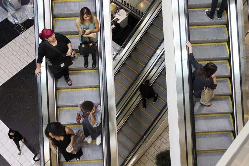 Shoppers ride escalators at the Beverly Center mall in Los Angeles, California November 8, 2013. REUTERS/David McNew