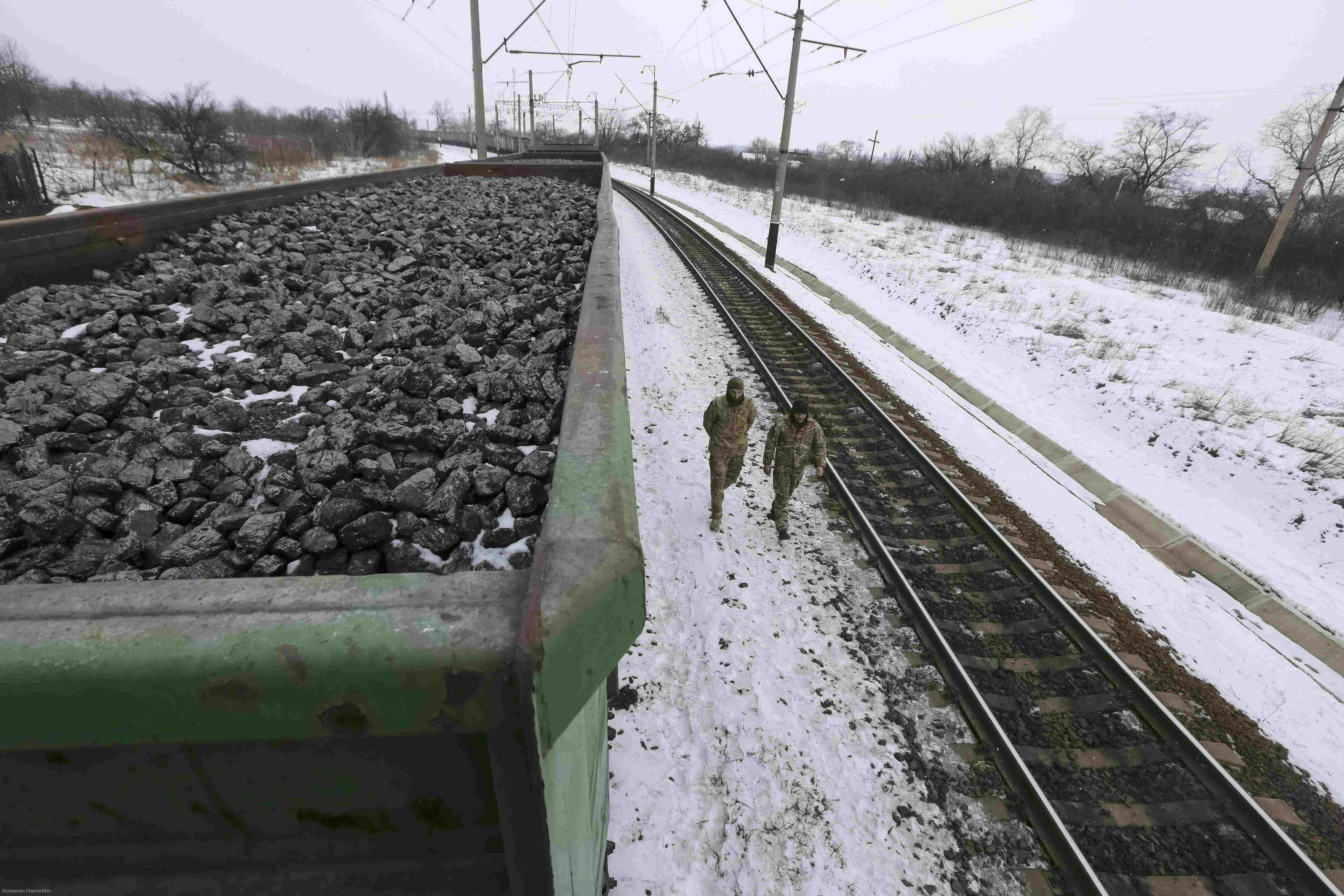 FILE PHOTO: Activists walk along carriages loaded with coal from the occupied territories which they blocked at Kryvyi Torets station in the village of Shcherbivka in Donetsk region, Ukraine, February 14, 2017. REUTERS/Konstantin Chernichkin/File Photo