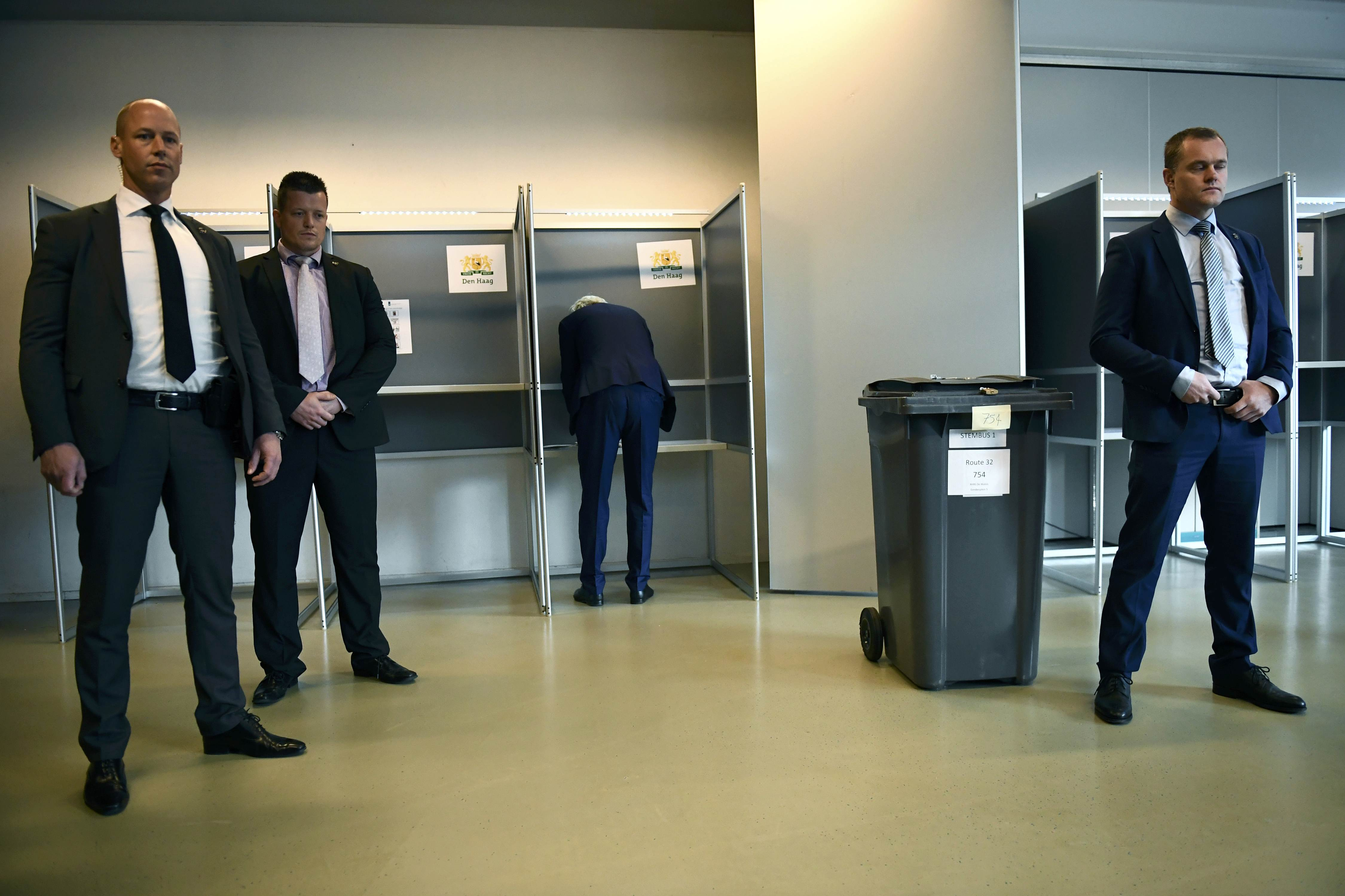 Dutch far-right politician Geert Wilders of the PVV party surrounded by security as he votes in the general election in The Hague, Netherlands, March 15, 2017. REUTERS/Dylan Martinez