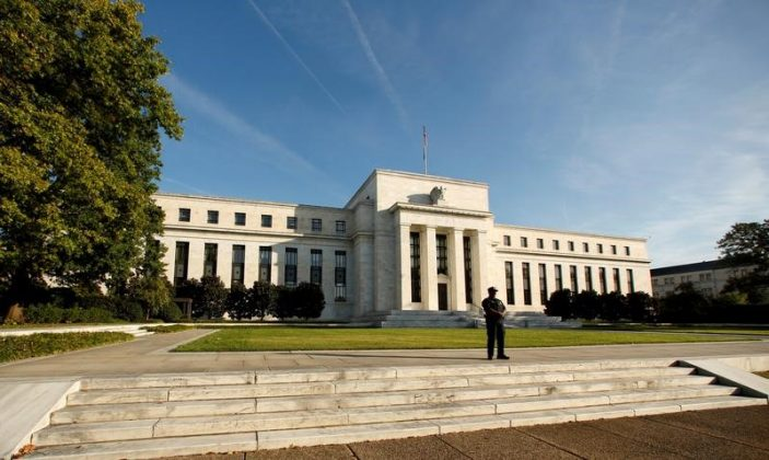 A police officer keeps watch in front of the U.S. Federal Reserve building in Washington, DC,