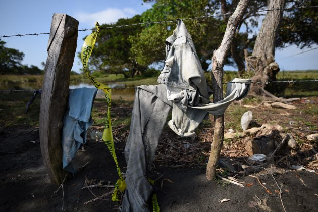 Clothing is pictured on a wire fence at site of unmarked graves where a forensic team and judicial authorities are working in after human skulls were found, in Alvarado, in Veracruz state, Mexico,