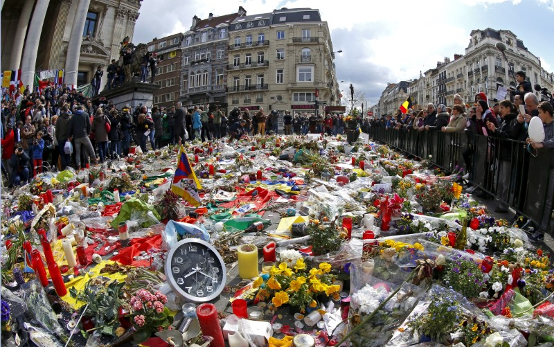 """People take part in a rally called """"The march against the fear, Tous Ensemble, Samen Een, All Together"""" in memory for the victims of bomb attacks in Brussels metro and Brussels international airport of Zaventem, in Brussels, Belgium, April 17, 2016. REUTERS/Yves Herman/File Photo"""