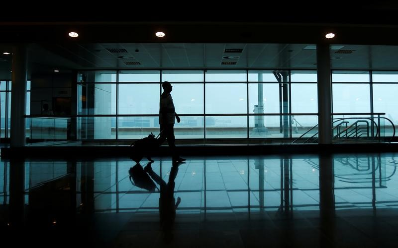 A passenger walks to his gate at Cairo International Airport. REUTERS/Amr Abdallah Dalsh