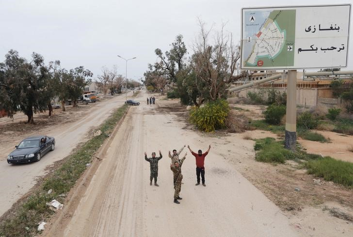 Members of East Libyan forces celebrate as they open Tripoli road after they captured the final holdout of Islamist-led rivals in the southwest of Benghazi, Libya, March 21, 2017. REUTERS/Esam Omran Al-Fetori
