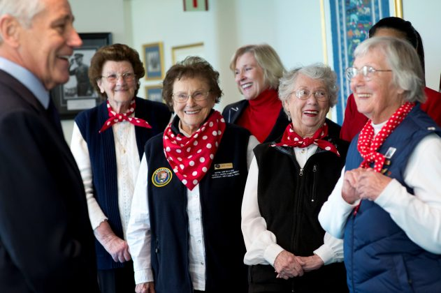 Secretary of Defense Chuck Hagel (L) laughs with, (L-R) Marian Wynn, Agnes Moore, Marian Sousa and Phyllis Gould, women who worked during World War II, at the Pentagon, in Arlington, Virginia, U.S., March 31, 2014. Erin A. Kirk-Cuomo/DOD/Handout via REUTERS