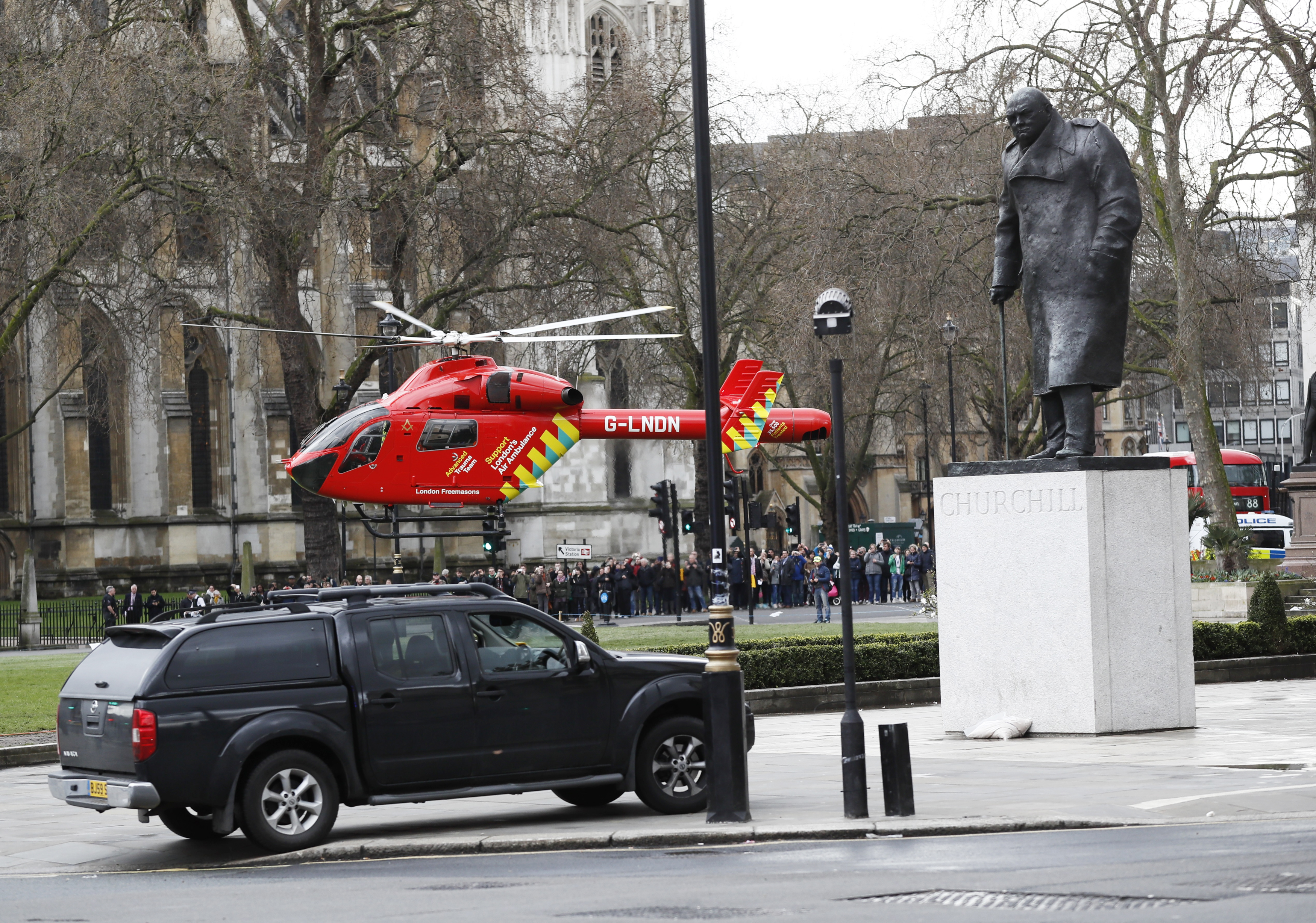 An air ambulance lands in Parliament Square during an incident on Westminster Bridge in London. REUTERS/Stefan Wermuth