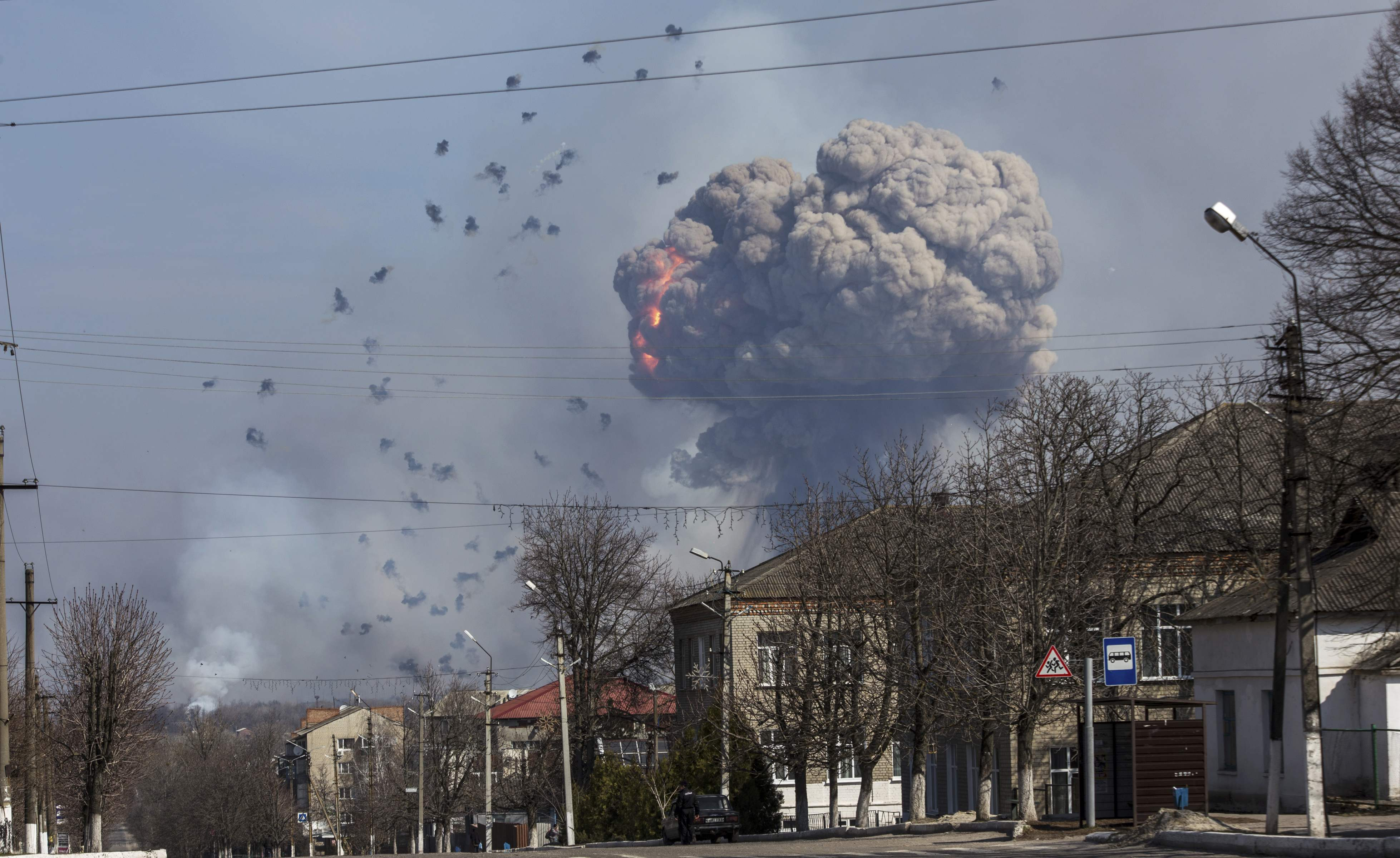 Flames shoot into the sky from a warehouse storing tank ammunition at a military base in the town of Balaklia (Balakleya), Kharkiv region, Ukraine, March 23, 2017. REUTERS/Alexander Sadovoy