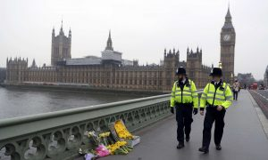 Flowers are placed at the scene of an attack on Westminster Bridge, in London, Britain March 24, 2017. REUTERS/Darren Staples