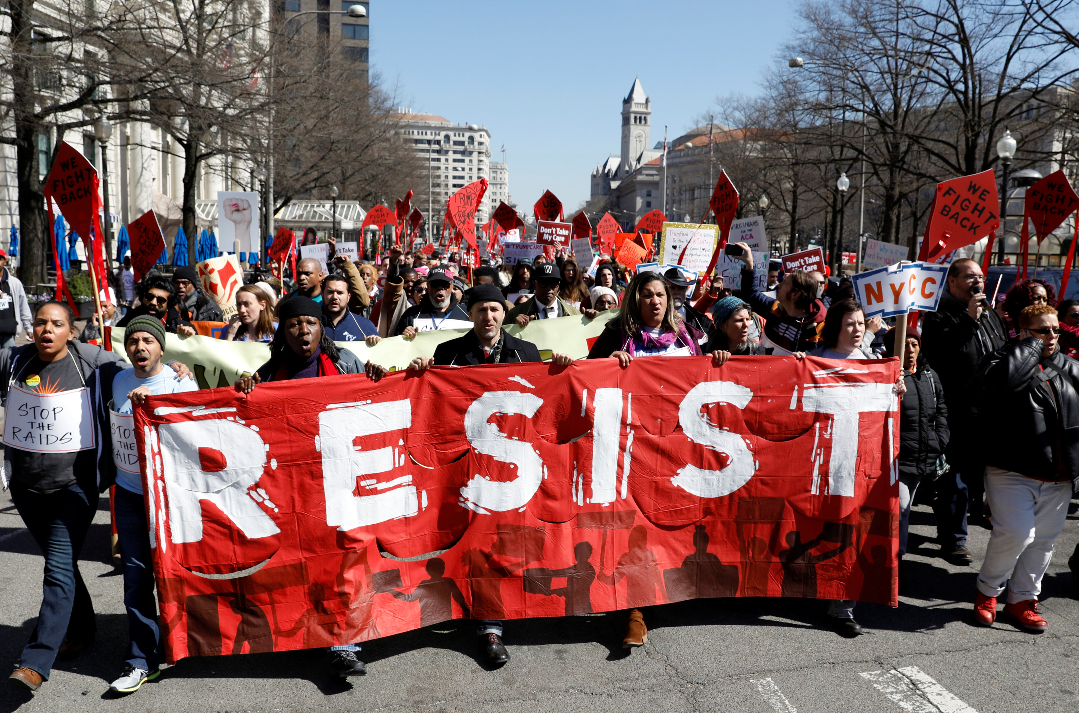Protesters demonstrate against U.S. President Donald Trump and his plans to end Obamacare as they march to the White House in Washington, U.S., March 23, 2017. REUTERS/Kevin Lamarque