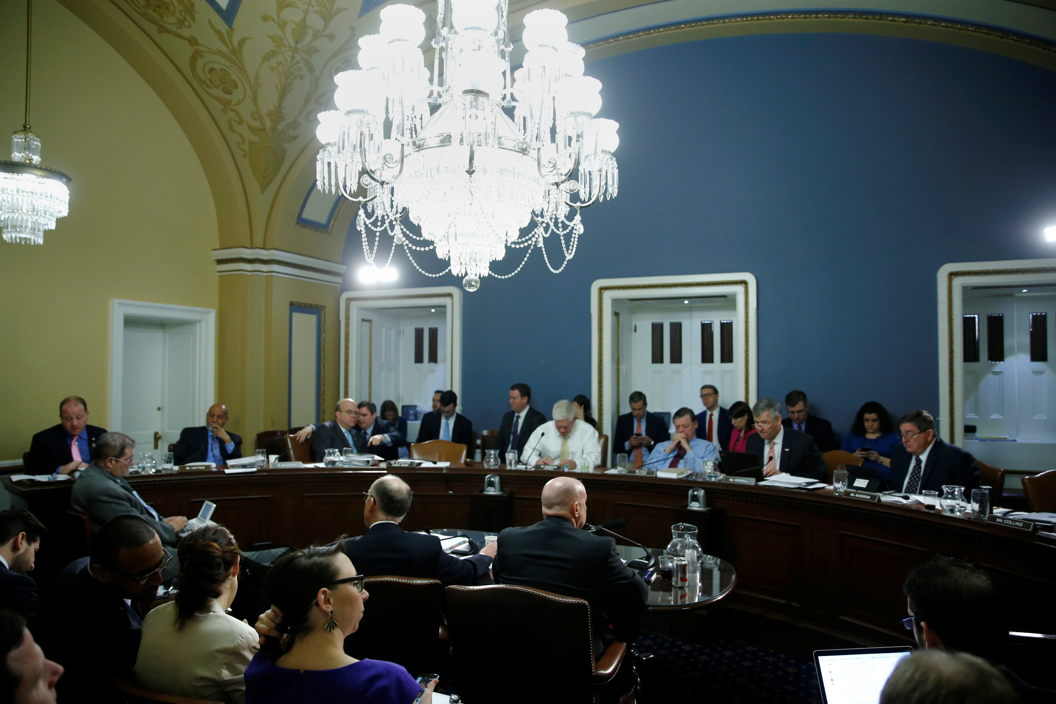U.S. House Energy and Commerce Committee Chairman Representative Greg Walden (R-OR) (center L, at table) and Ways and Means Committee Chairman Representative Kevin Brady (R-TX) (center R, at table) testify at an early-morning Rules Committee hearing as Congress considers health care legislation to repeal Obamacare at the U.S. Capitol in Washington, U.S., March 24, 2017. REUTERS/Jonathan Ernst