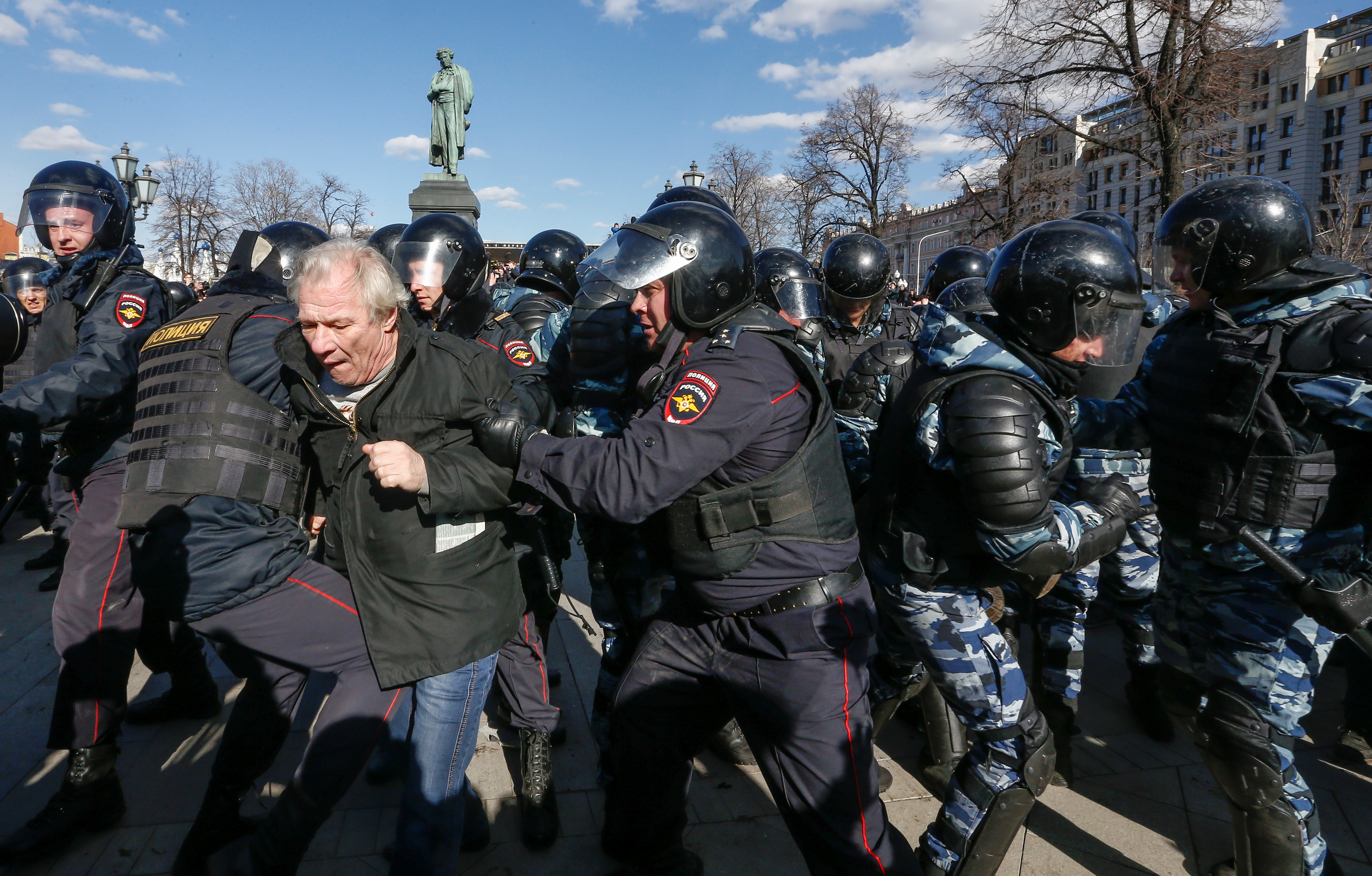 Law enforcement officers detain an opposition supporter during a rally in Moscow.