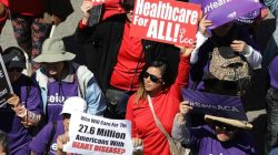 """People march in a """"Save Obamacare"""" rally in Los Angeles."""