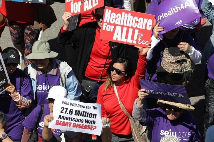 "People march in a ""Save Obamacare"" rally in Los Angeles."