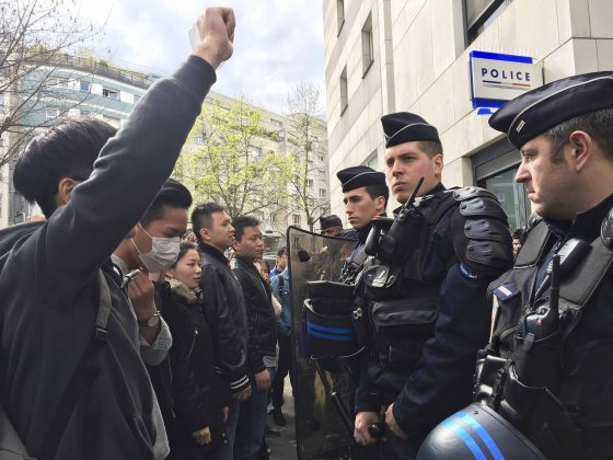 French police face off with members of the Chinese community during a protest demonstration outside a police station in Paris, France, March 28, 2017, after a Chinese man was shot dead by police at his Paris home on Sunday, triggering riots in the French capital by members of the Chinese community and a diplomatic protest by Beijing. REUTERS/Noemie Olive