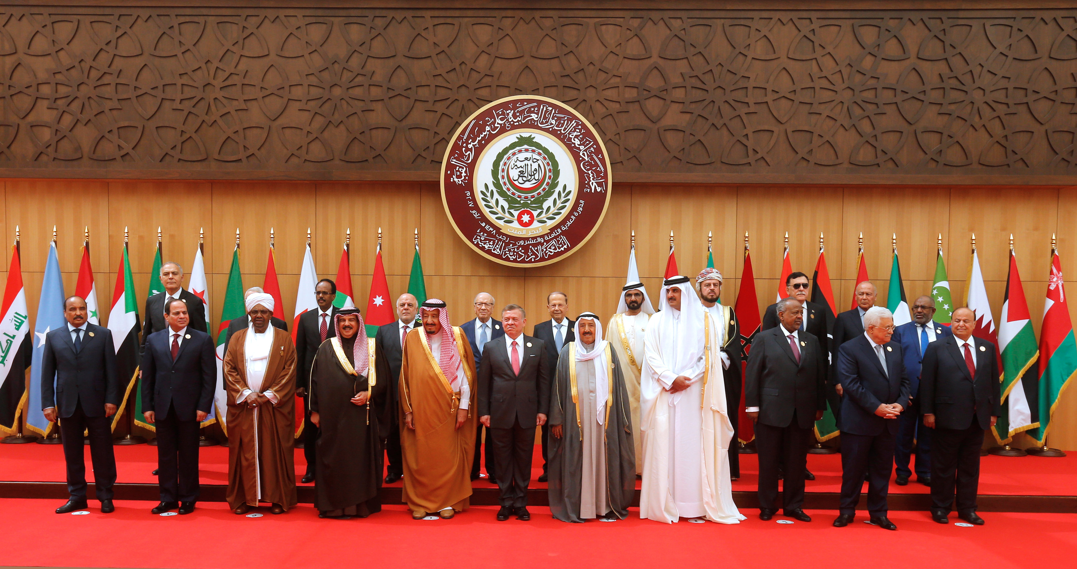 (front R-L) Yemen's President Abd-Rabbu Mansour Hadi, Palestinian President Mahmoud Abbas, Djibouti's President Ismail Omar Guelleh, Qatari Emir Sheikh Tamim bin Hamad al-Thani, Emir of Kuwait Sabah Al-Ahmad Al-Jaber Al-Sabah, Jordan's King Abdullah II, Saudi Arabia's King Salman bin Abdulaziz Al Saud, Bahrain's King Hamad bin Isa Al Khalifa, Sudan's President Omar Al Bashir, Egypt's President Abdel Fattah al-Sisi, and Mauritania's President Mohamed Ould Abdel Aziz pose for a group photograph during the 28th Ordinary Summit of the Arab League at the Dead Sea, Jordan March 29, 2017. REUTERS/Mohammad Hamed