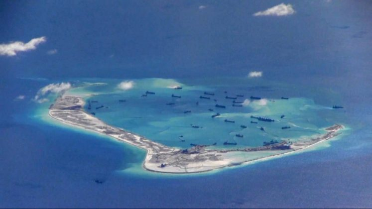 Chinese dredging vessels purportedly seen in the waters around Mischief Reef in the disputed Spratly Islands in the South China Sea, May 2015. U.S. Navy/Handout via Reuters