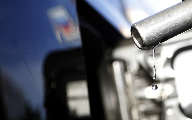 FILE PHOTO: Gasoline drips off a nozzle during refueling at a gas station in Altadena, California March 24, 2012. REUTERS/Mario Anzuoni
