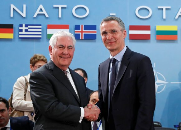 U.S. Secretary of State Rex Tillerson shakes hands with NATO Secretary General Jens Stoltenberg. REUTERS/Yves Herman