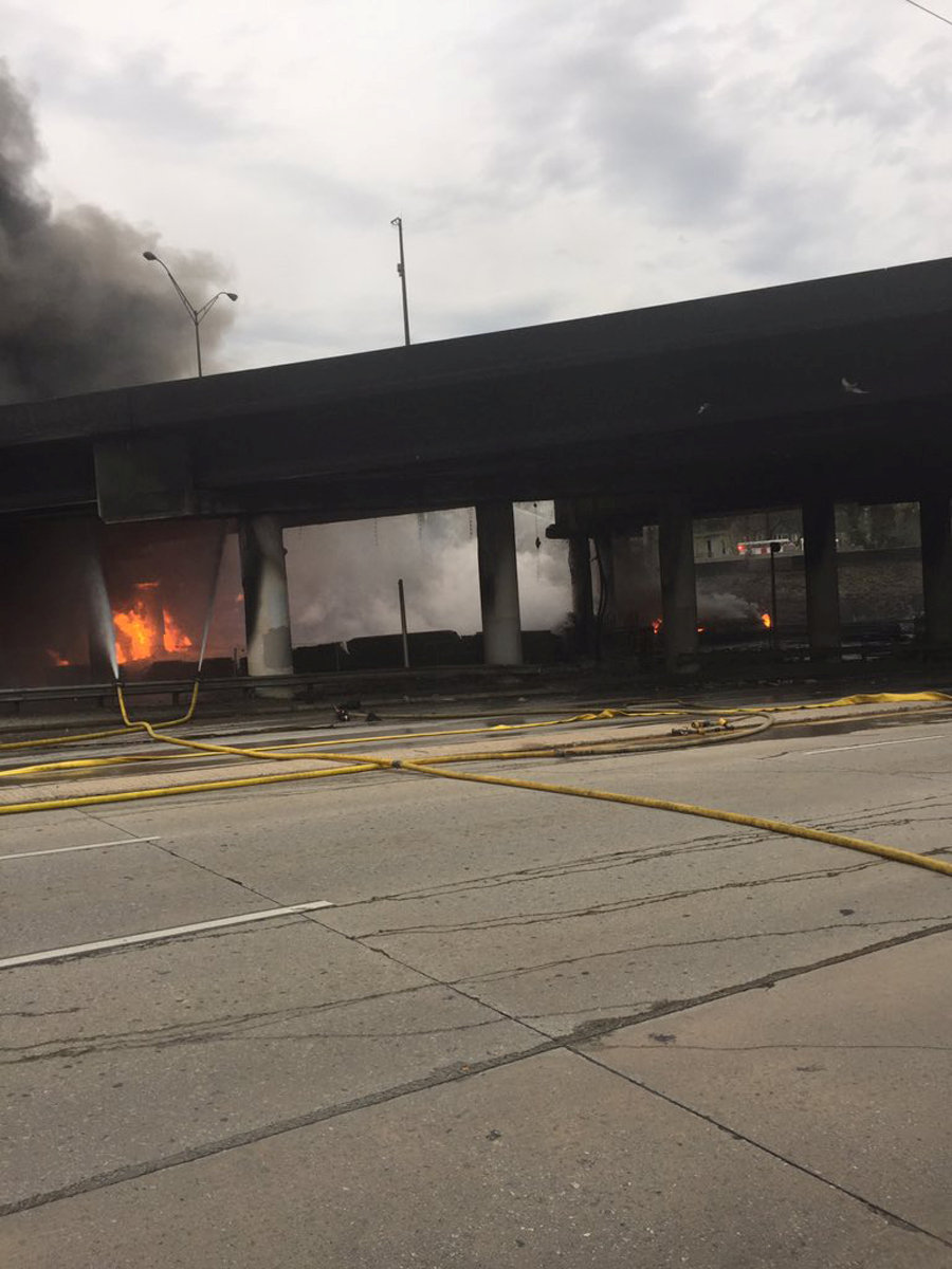A fire is shown out of control underneath a highway overpass on interstate 85 before a section of the highway collapsed, according to the city's fire and rescue agency in Atlanta, Georgia, March 30, 2017. Atlanta Fire Rescue/Handout via REUTERS