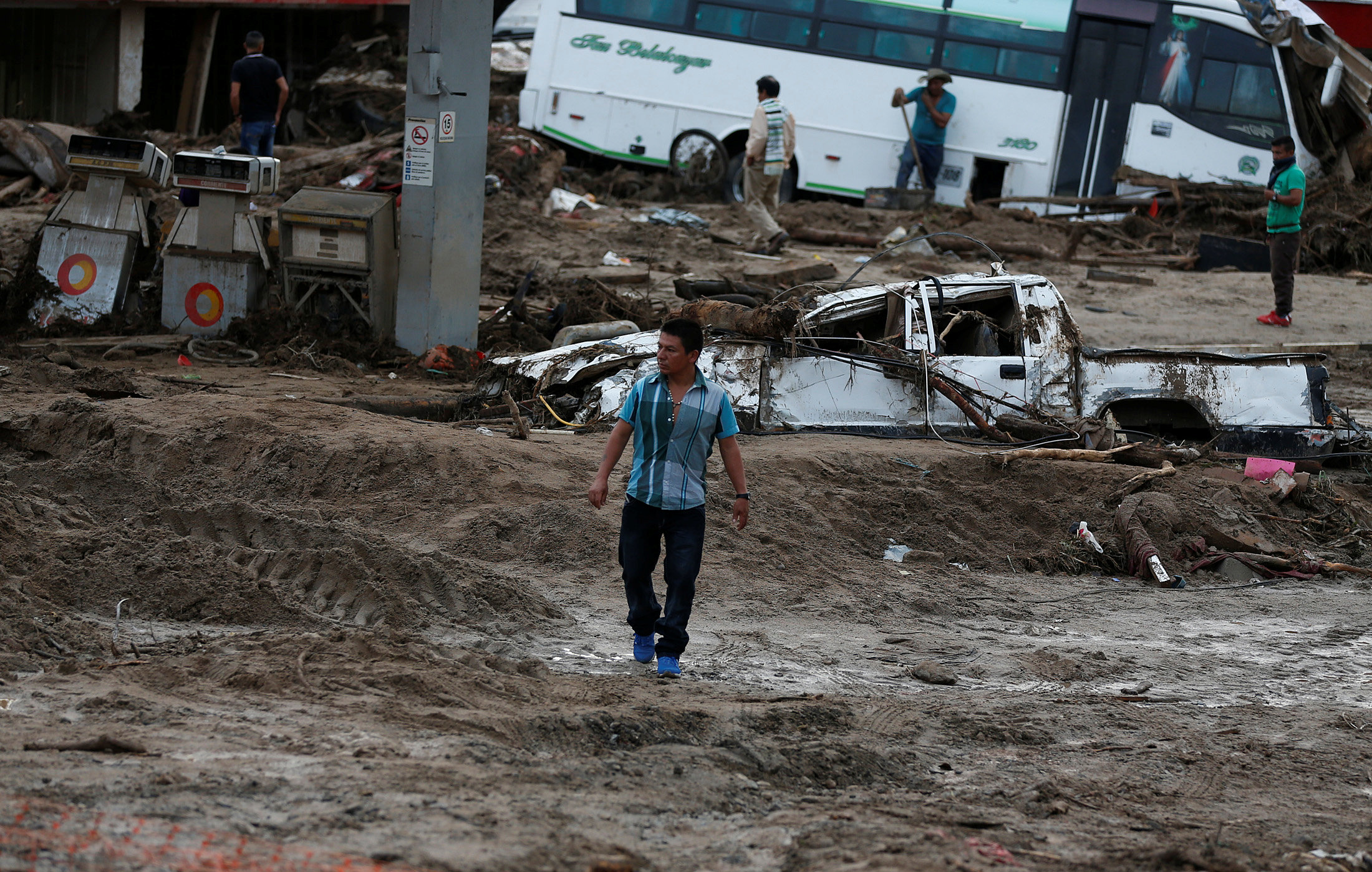 A man walks among the ruins after flooding and mudslides, caused by heavy rains leading several rivers to overflow, pushing sediment and rocks into buildings and roads, in Mocoa, Colombia