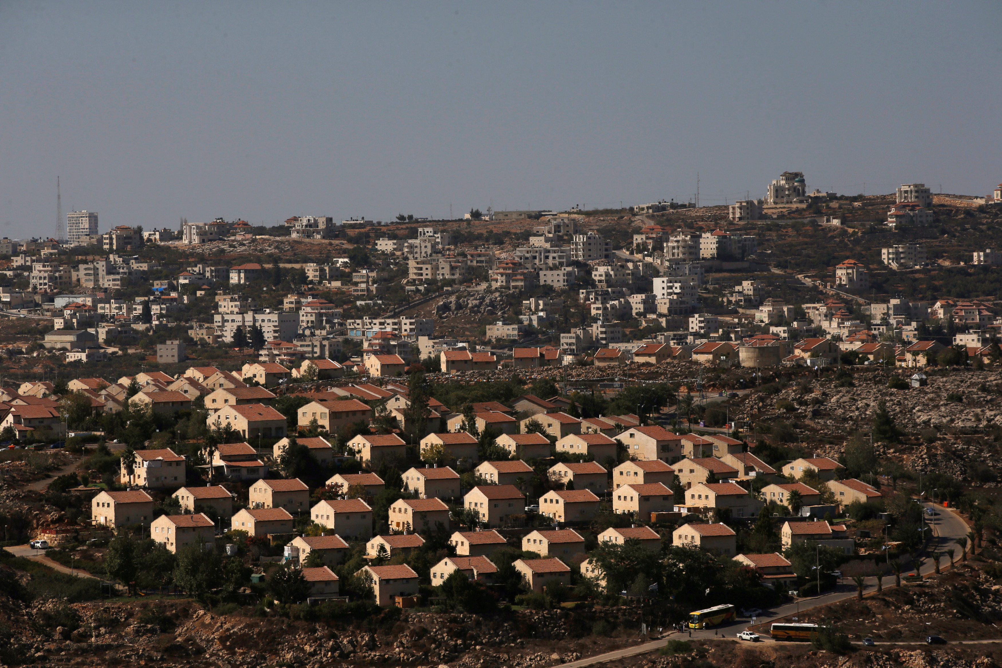 The West Bank Jewish settlement of Ofra is photographed as seen from the Jewish settler outpost of Amona in the occupied West Bank, October 20, 2016. The Palestinian village of Silwad is seen in the background.