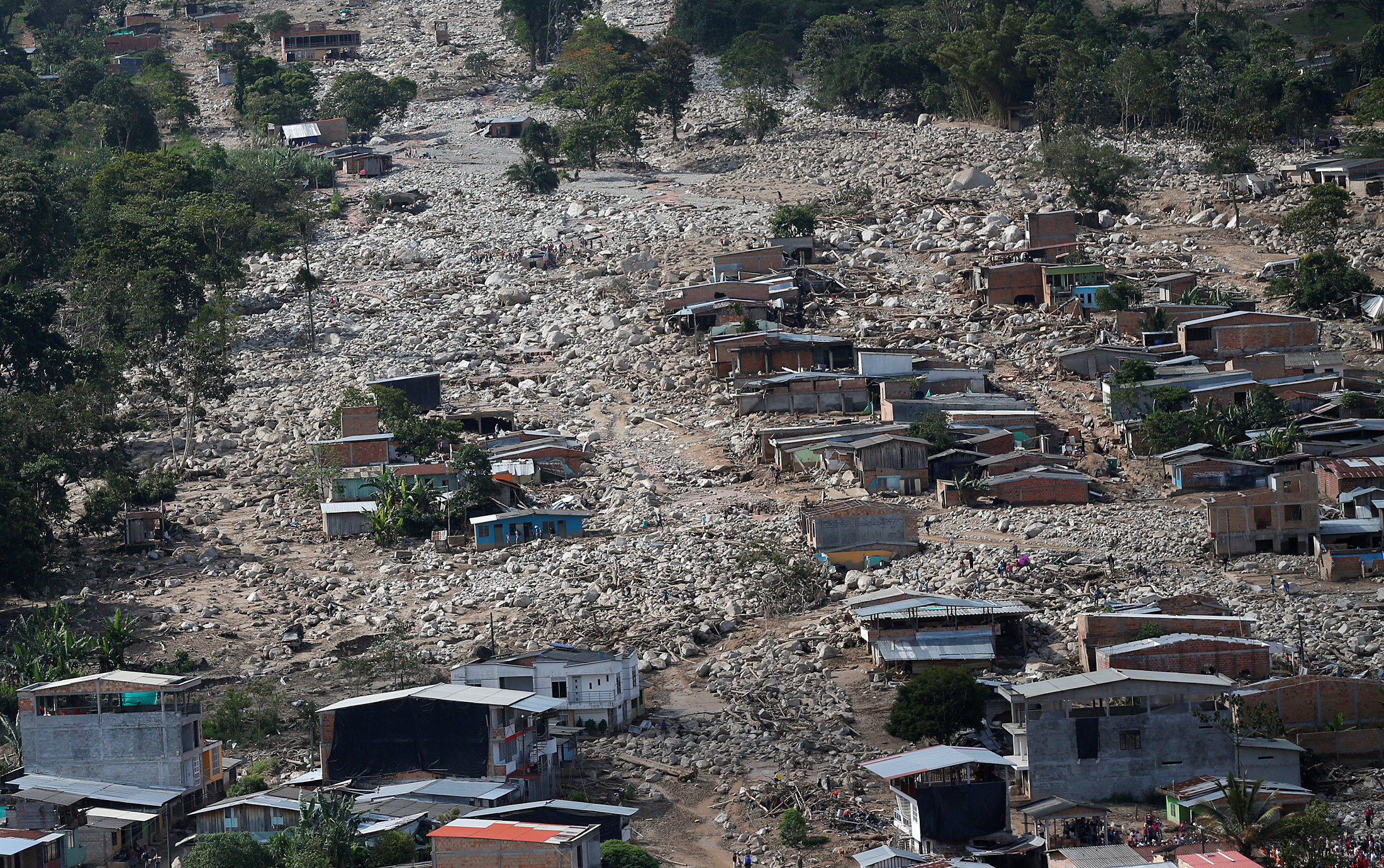Aerial view of a neighborhood destroyed after flooding and mudslides caused by heavy rains leading several rivers to overflow, pushing sediment and rocks into buildings and roads, in Mocoa, Colombia April 3, 2017. REUTERS/Jaime Saldarriaga