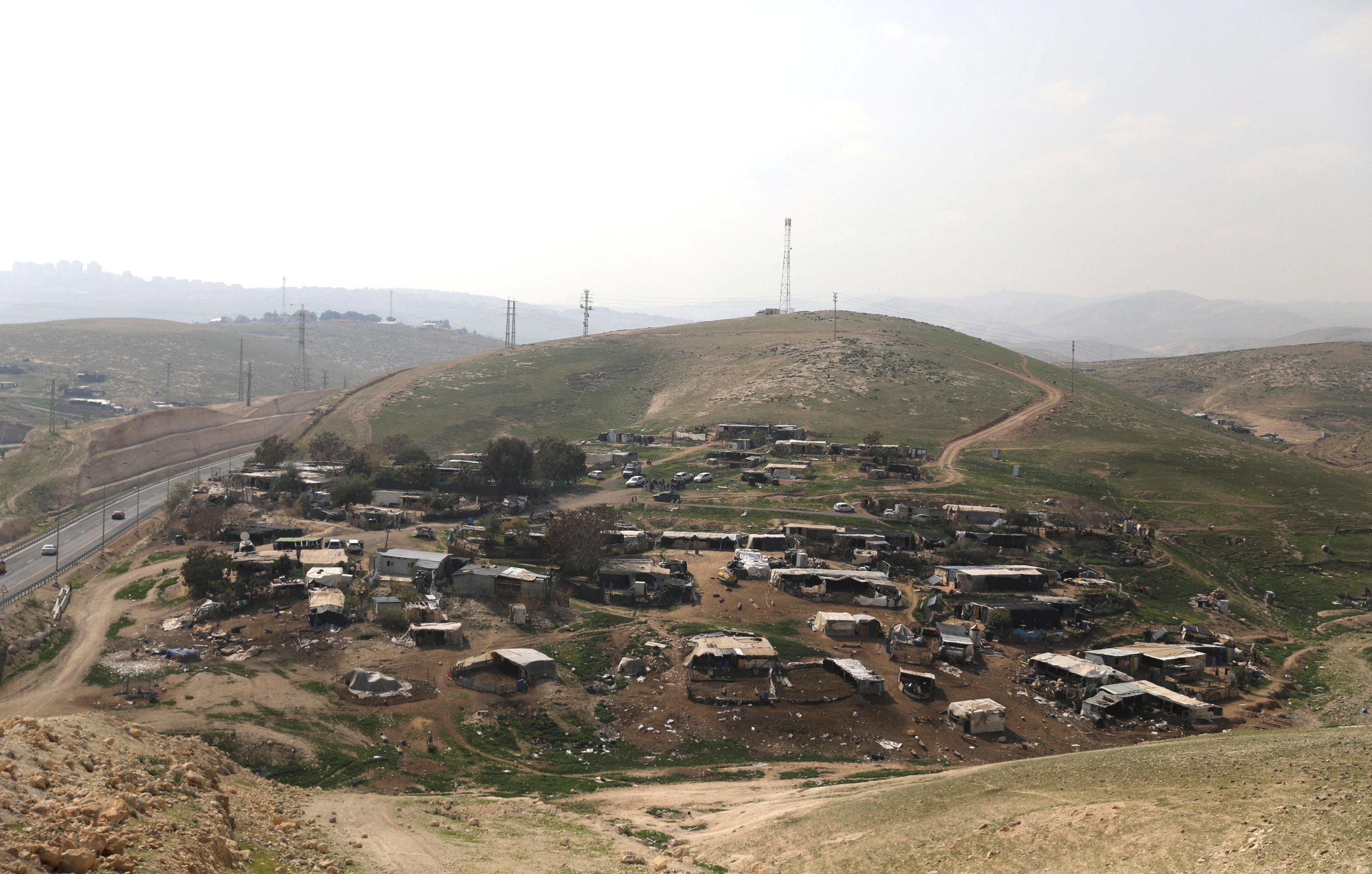 FILE PHOTO: Dwellings belongings to Bedouin are seen in al-Khan al-Ahmar village near the West Bank city of Jericho February 23, 2017. REUTERS/Ammar Awad/File Photo
