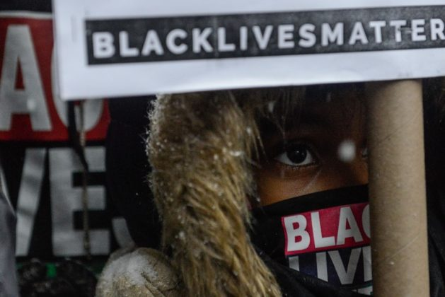 People participate in a Black Lives Matter protest in front of Trump Tower in New York City, U.S. January 14, 2017. REUTERS/Stephanie Keith