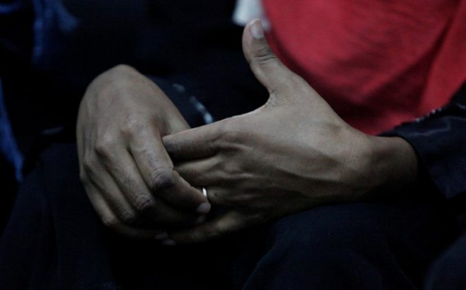 FILE PHOTO: An Eritrean migrant touches a ring on her hand at a military building in Misrata, Libya, November 6, 2016. REUTERS/Ismail Zitouny
