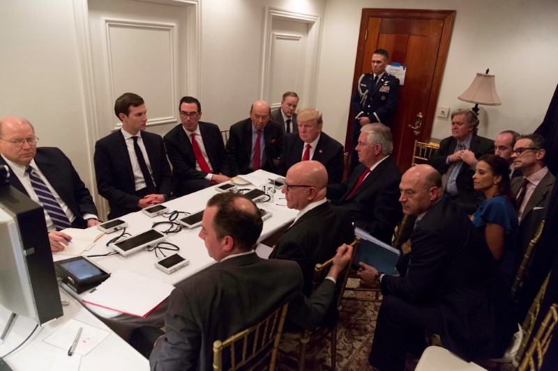 President Trump meeting with his National Security team and being briefed by Chairman of the Joint Chiefs of Staff General Joseph Dunford via secure video after a missile strike on Syria while inside the Sensitive Compartmented Information Facility at his Mar-a-Lago resort in West Palm Beach, Florida. White House Press Secretary Sean Spicer stated that this image has been digitally edited for security purposes.