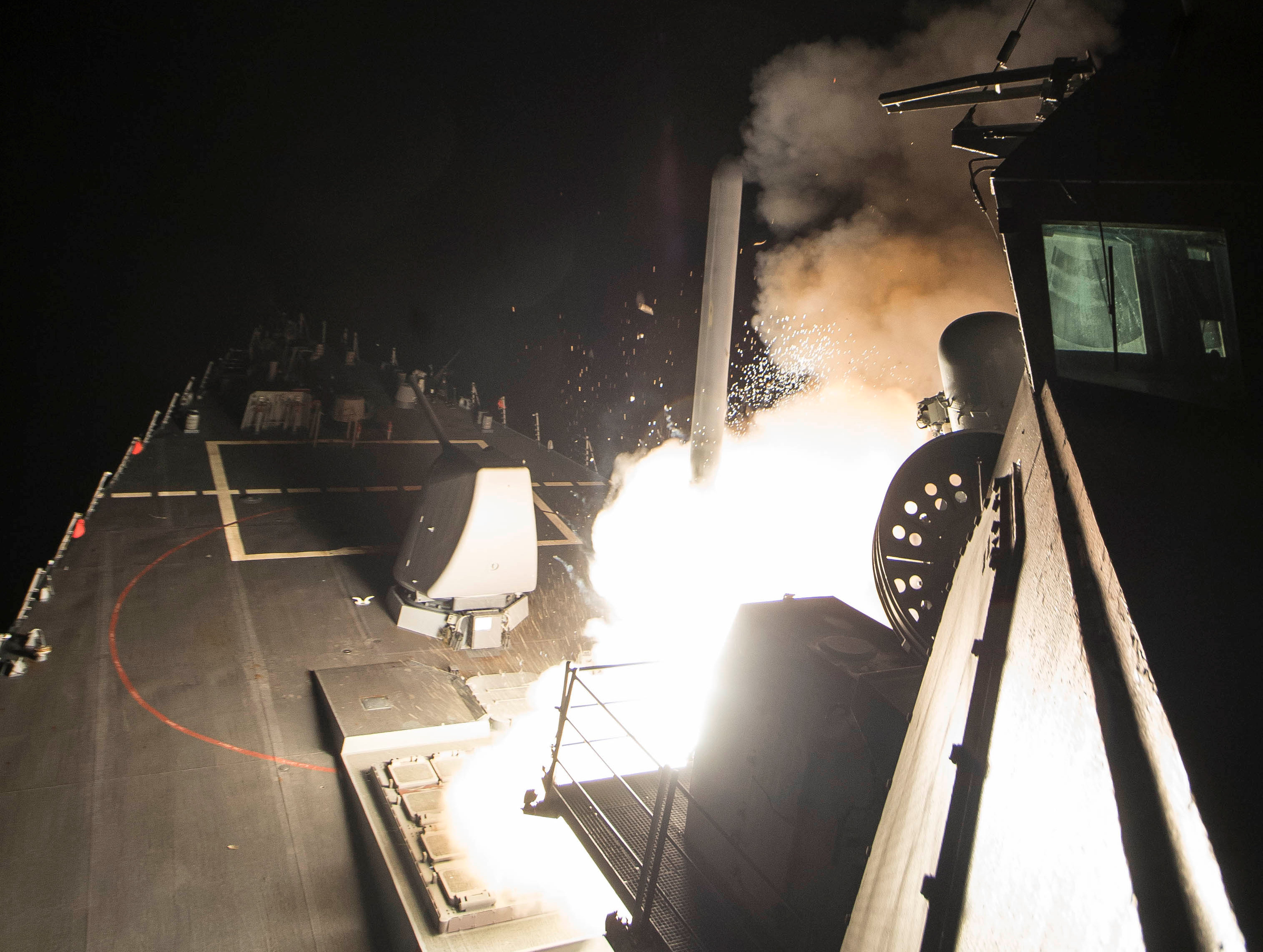 U.S. Navy guided-missile destroyer USS Ross fires a tomahawk land attack missile in Mediterranean Sea, part of a cruise missile strike against Syria. Robert S. Price/Courtesy U.S. Navy